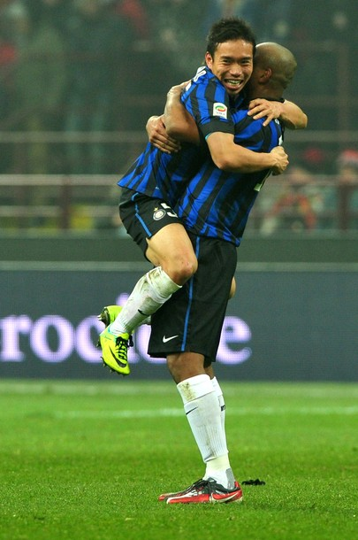 Yuto and Maicon celebrate the derby win