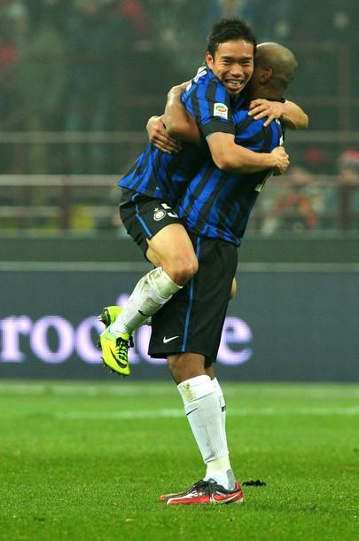 Yuto and Maicon celebrate the derby win