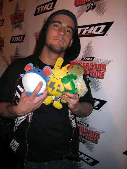 Cm-punk-with-toys-in-his-hands_medium