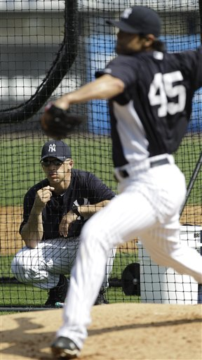 Joe Girardi will have a lot of decisions to make this spring. (AP)