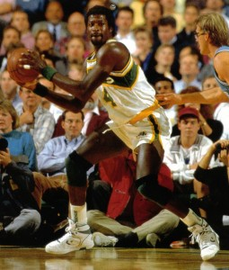 Michael Cage dominating the the paint like a real man.  He was called the Windex Man for his pension of cleaning the glass.