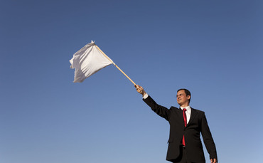 Businessman-white-flag-370x229_medium