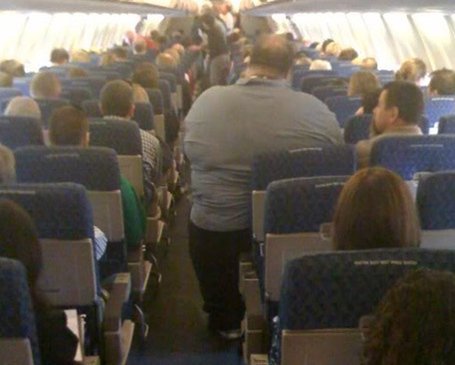 Ts-fat-guy-on-airplane_medium