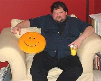 Fat_guy_in_happy_chair_medium