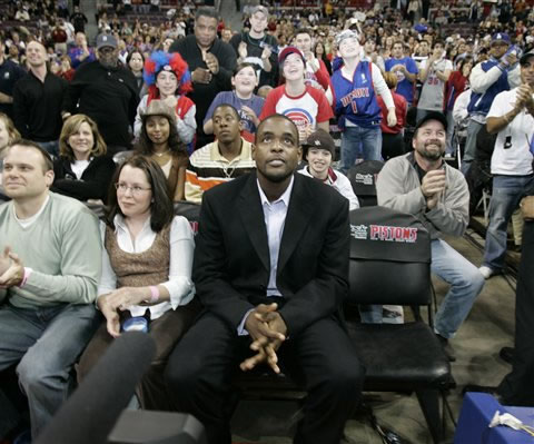 Chris Webber watches from the stands