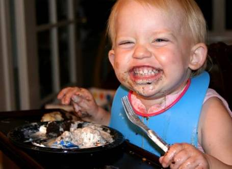 Child-eating-cake-and-ice-cream_medium
