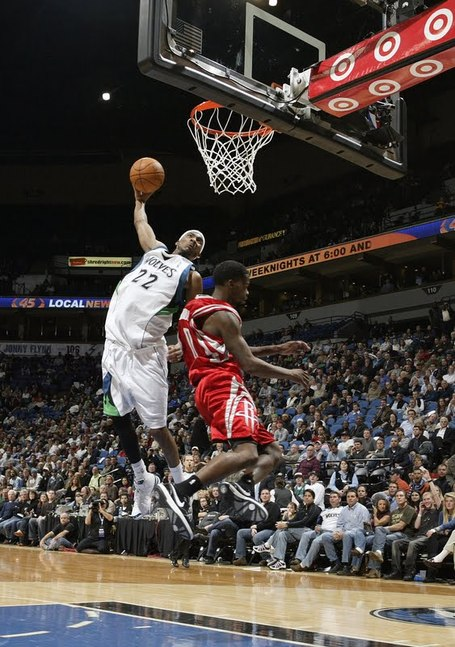 Corey_brewer_dunks_on_aaron_brooks_medium