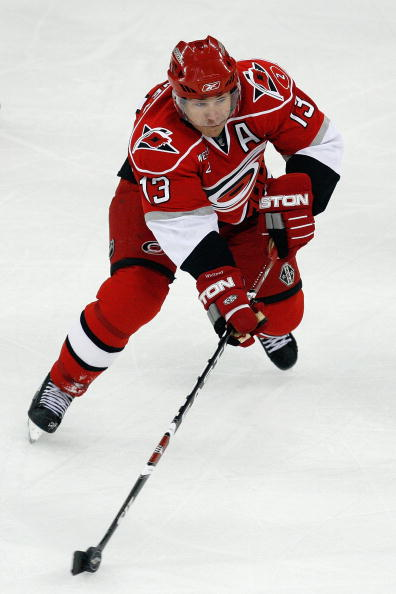 Ray-whitney-of-the-carolina-hurricanes-skates-with-the-puck-against-the-boston-bruins_medium