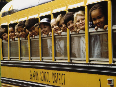 Rubenstein-len-school-children-looking-out-school-bus-windows_medium