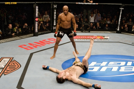 Anderson_silva_ufc101_standing_over_griffin-450x300_medium