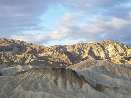 Zabriskie_point_at_sunrise_in_death_valley_np_medium