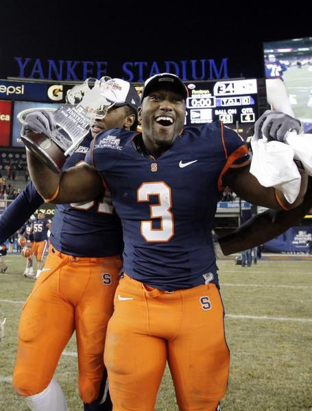 Syracuse-orange-delone-carter-reacts-with-the-mvp-trophy-at-the-inaugural-pinstripe-bowl-at-yankee-stadium-in-new-york_medium