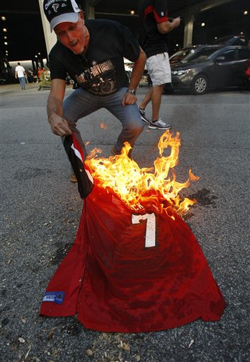 PHOTOS: Michael Vick Jersey Burning In Georgia Dome Parking Lot ...