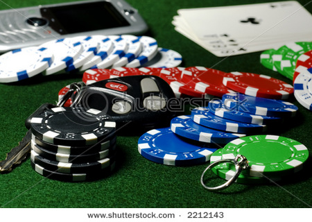 Stock-photo-poker-pot-of-chips-car-keys-diamond-ring-and-cell-phone-2212143_medium