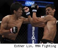 Mizugaki punches Escovedo at UFC 135.