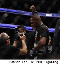 Jon Jones wears the UFC light heavyweight belt at UFC 128.