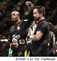 Anderson Silva's hand is raised after win.