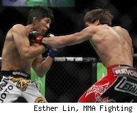 Brian Bowles punches Takeya Mizugaki at UFC 132