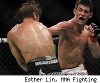 Dominick Cruz punches Urijah Faber at UFC 132.