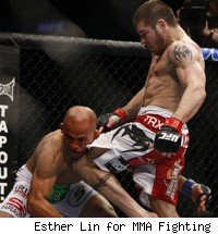Jim Miller knees Kamal Shalorus at UFC 128.