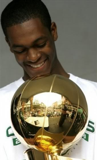 Rr-with-champion-cup-of-nba-2007-08-rajon-rondo-11592534-340-563_medium