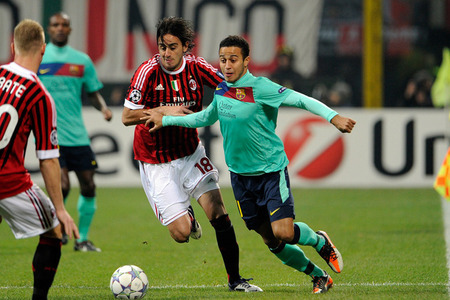 MILAN, ITALY - NOVEMBER 23:  Alberto Aquilani of AC Milan and Thiago Alcantara of FC Barcelona contest for a round during a UEFA Champions League organisation H compare between AC Milan and FC Barcelona during Giuseppe Meazza Stadium on Nov 23, 2011 in Milan, Italy.  (Photo by Claudio Villa/Getty Images)